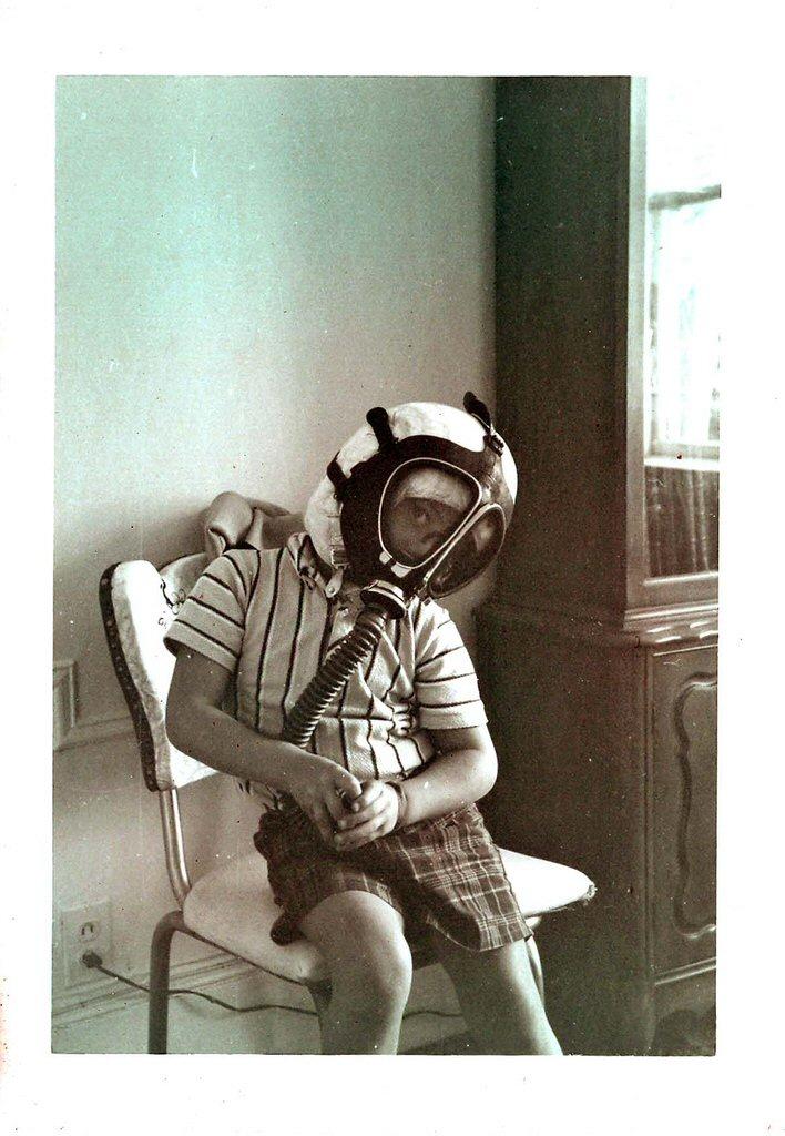 boy wearing gasmask