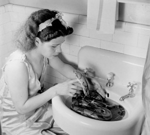 woman with snake in sink