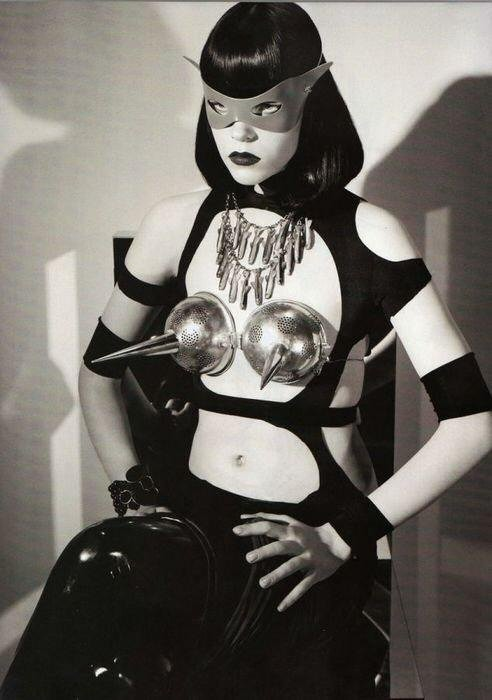 dominatrix wearing pointy bra