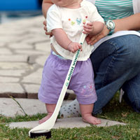 Baby with hockey stick