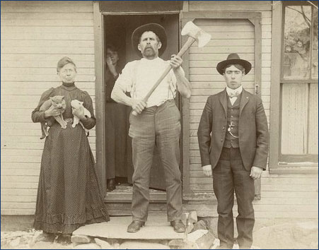 vintage photo of man with ax, women with two cats, and silly looking man.