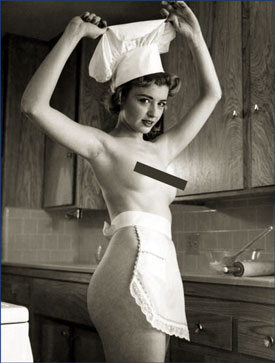 women wearing only apron an chef's hat in kitchen