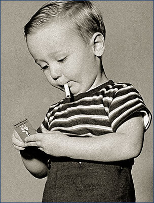 young child sparking up a ciggy