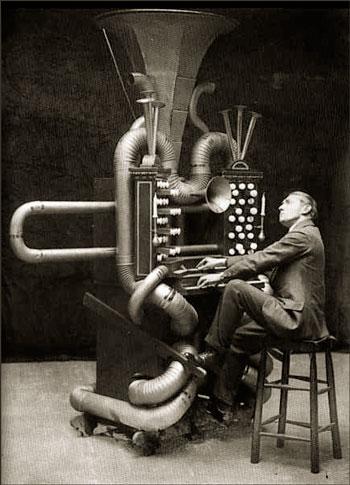 man playing strange musical instrument