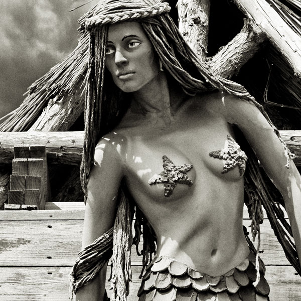 figurehead -- wooden mermaid