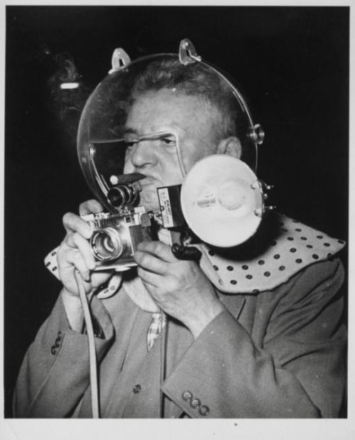 man with cigar, glass helmet and camera