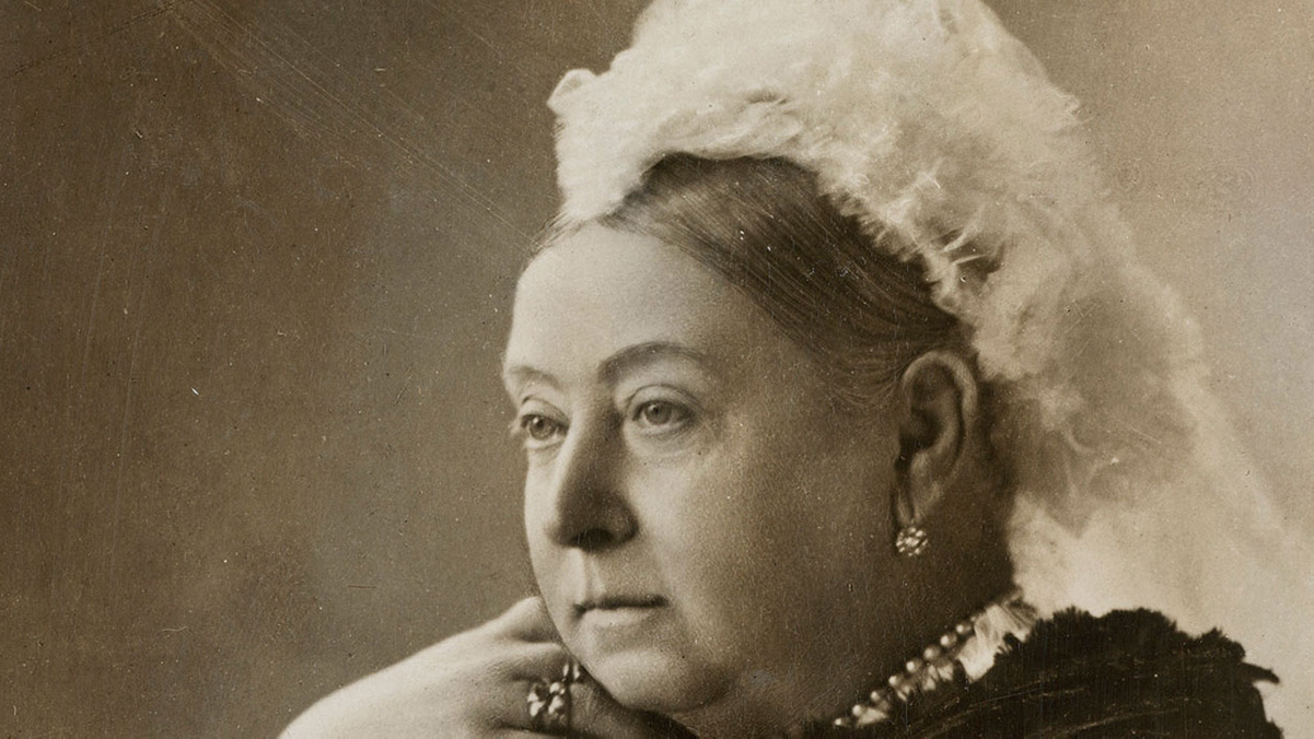 Queen Victoria, gazing to the left while wearing froufrou head gear