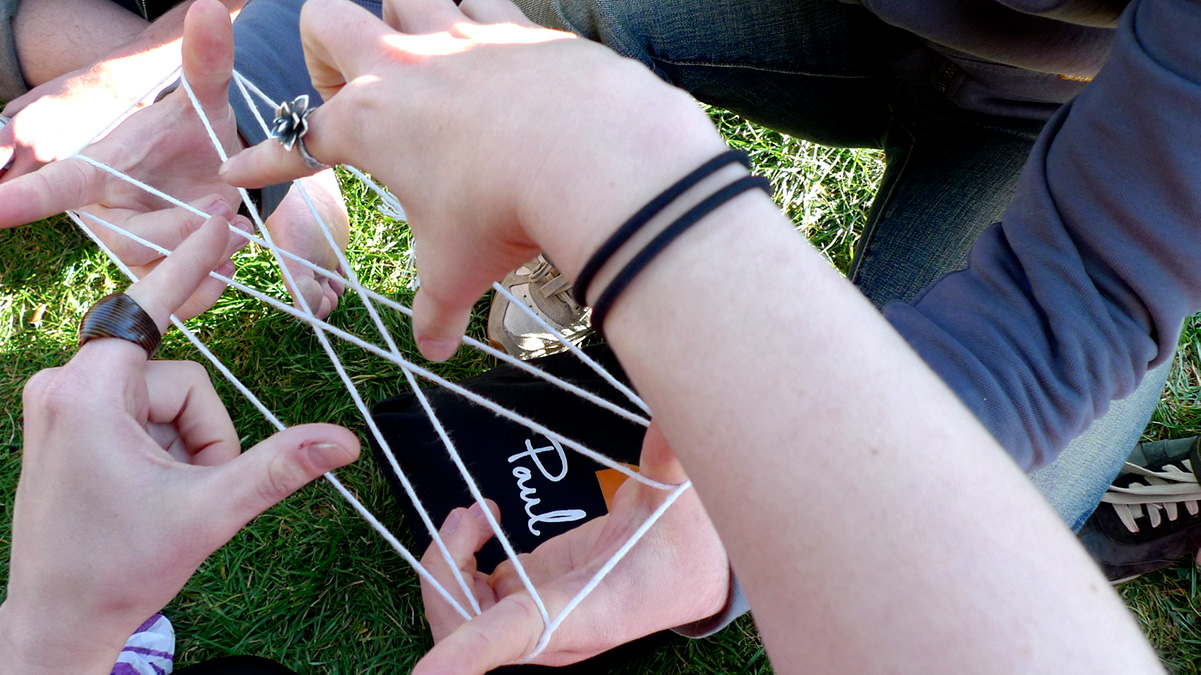 playing cat's cradle in the park