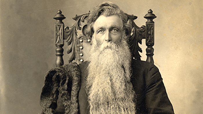 old man with haunted look and extremely long beard